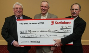Cheque presented: Scotiabank donated $25,000 to the Miramichi Salmon Association. From left are: Manley Price, chairman Miramachi Salmon Association; Mark Hambrook, president; and Tony Harris, Scotiabank manager at Smythe street branch.  Photo: Stephen MacGillivray/The Daily Gleaner